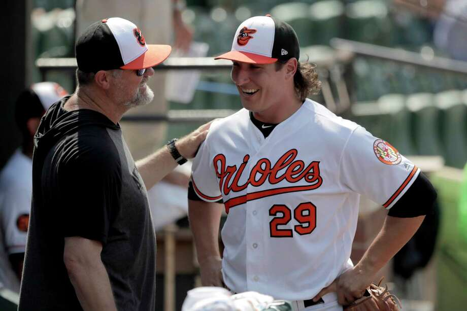 Baltimore Orioles starting pitcher Asher Wojciechowski, right, talks to pitching coach Doug Brocail in the dugout after being pulled from the mound during the eighth inning of a baseball game against the Baltimore Orioles, Sunday, July 21, 2019, in Baltimore. The Orioles won 5-0. (AP Photo/Julio Cortez) Photo: Julio Cortez / Copyright 2019 The Associated Press. All rights reserved.