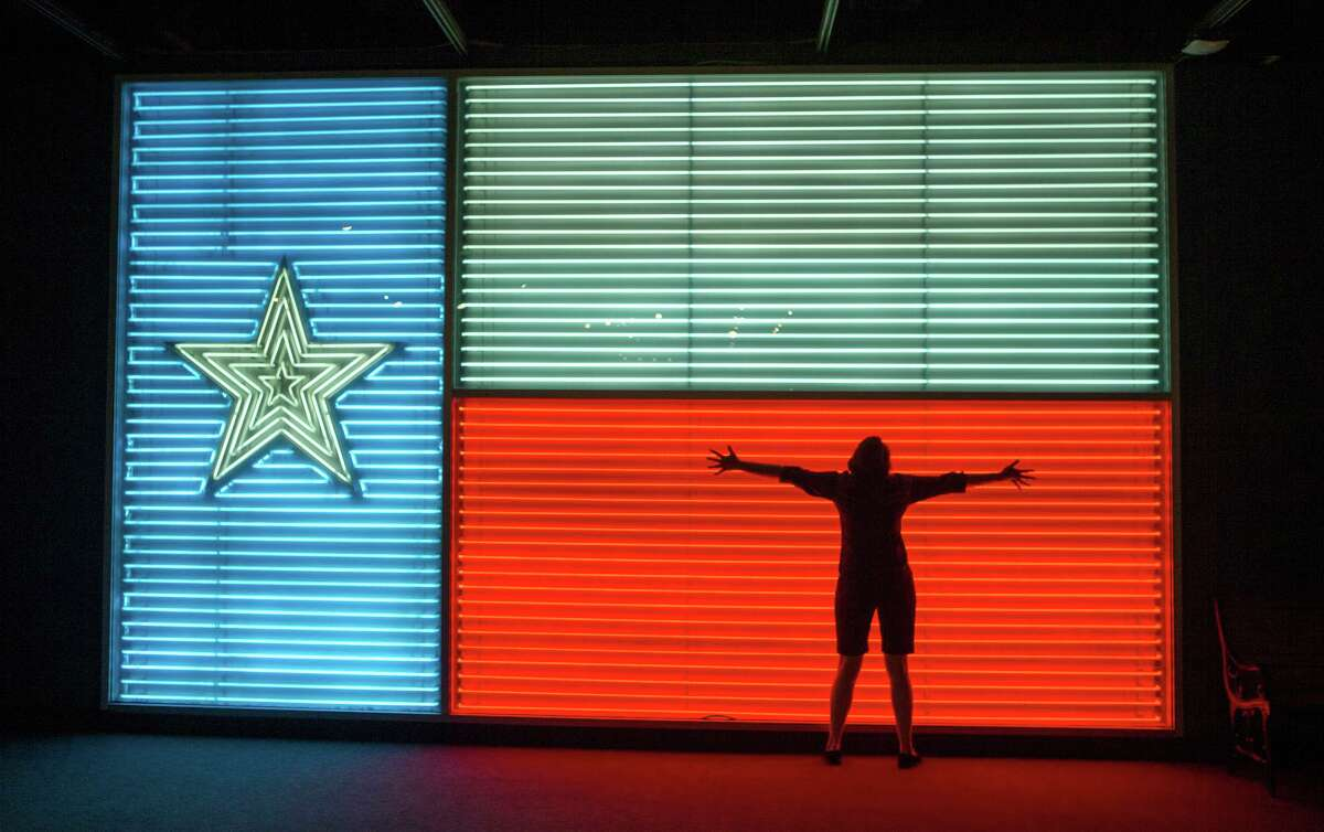 A neon Texas flag is a popular backdrop for photos at the Institute of Texan Cultures.