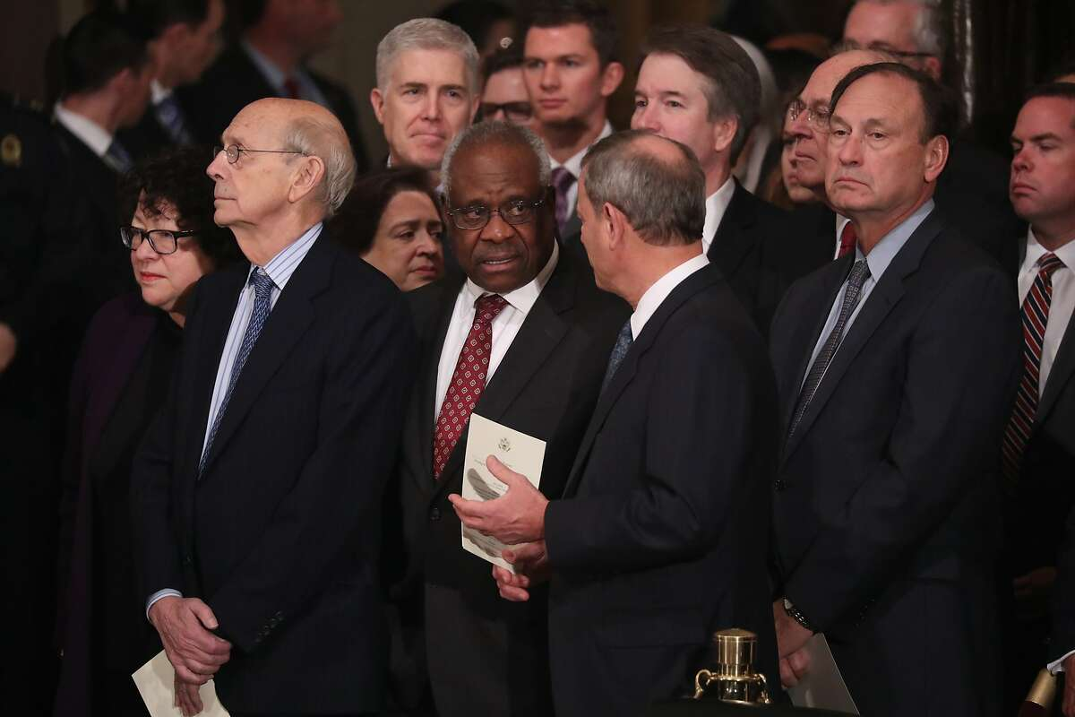 WASHINGTON, DC - DECEMBER 3: (AFP-OUT) Justices of the U.S. Supreme Court including (L-R) Associate Justices Sonia Sotomayor, Stephen Breyer, Elena Kagan, Neil Gorsuch, Clarence Thomas, Chief Justice John Roberts, Associate Justice Brett Kavanaugh, former