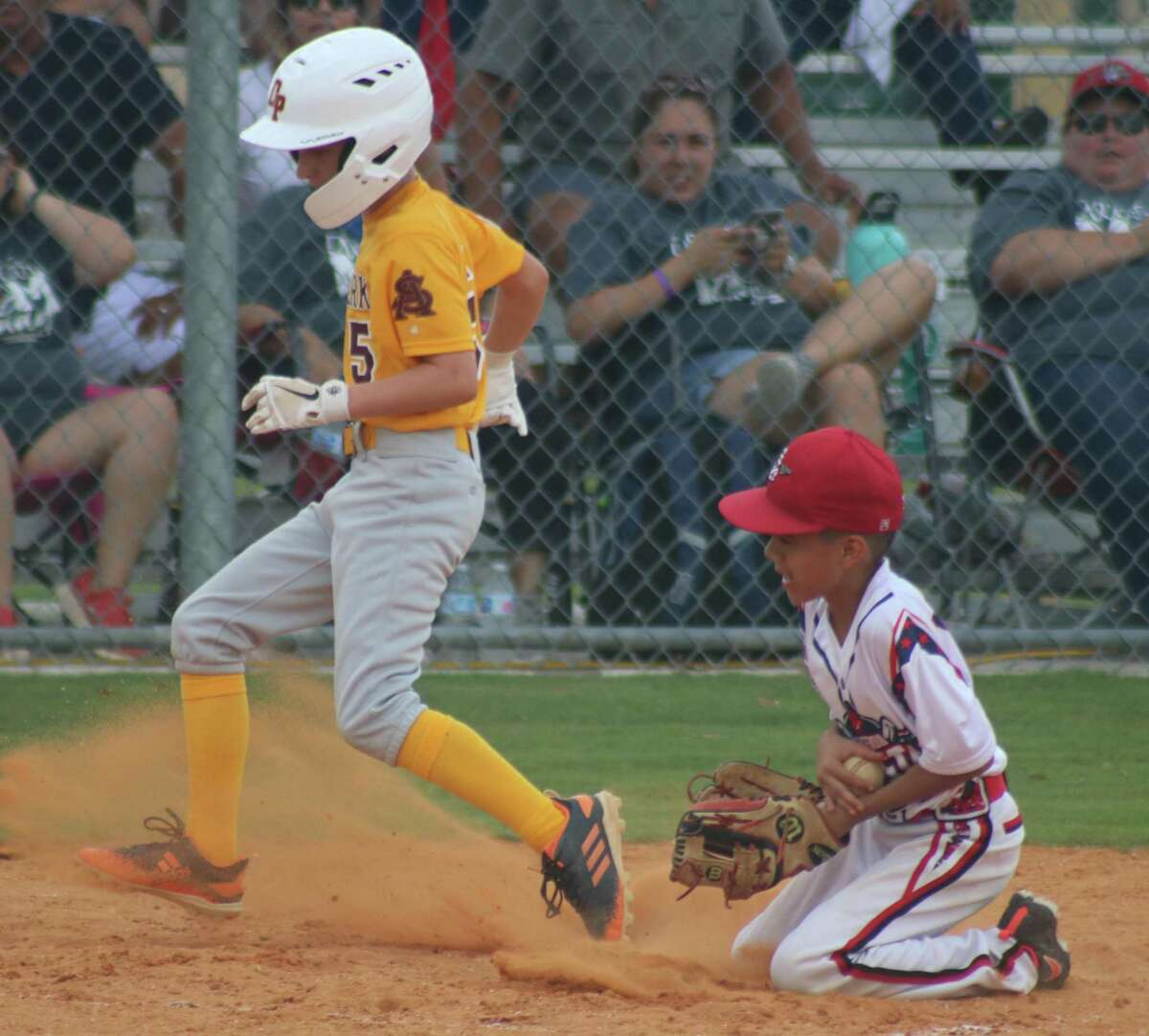 Deer Park Gold's Landin Hardin takes advantage of a wild pitch to score a run Saturday against the Mission All-Stars. The team went on to an 8-2 South Zone victory.
