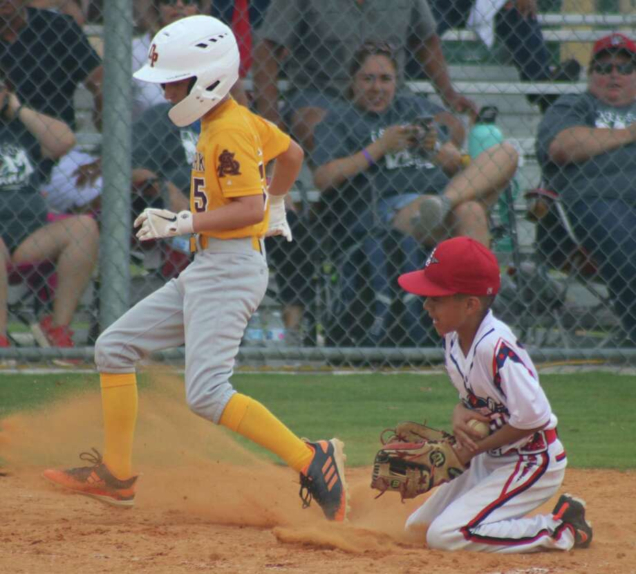 Deer Park Gold's Landin Hardin takes advantage of a wild pitch to score a run Saturday against the Mission All-Stars. The team went on to an 8-2 South Zone victory. Photo: Robert Avery