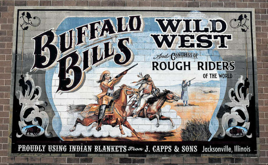 Buffalo Bill's Wild West and Congress of Rough Riders made at least five visits to Jacksonville between 1876 and 1911. This mural in a parking lot bordered by West College Avenue and South Sandy, South Main and West Morgan streets commemorates those visits. Photo: Marco Cartolano | Journal-Courier