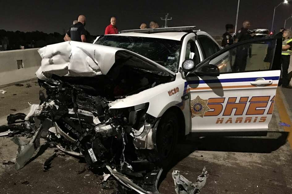 Harris County Sheriff's Office deputies investigate a deadly crash where a sheriff's office patrol car transporting a DWI suspect was hit head-on by another suspected drunk driver Sunday, July 21, 2019. The DWI suspect in the patrol car died en route to the hospital, while all others involved in the crash suffered non-life-threatening injuries.