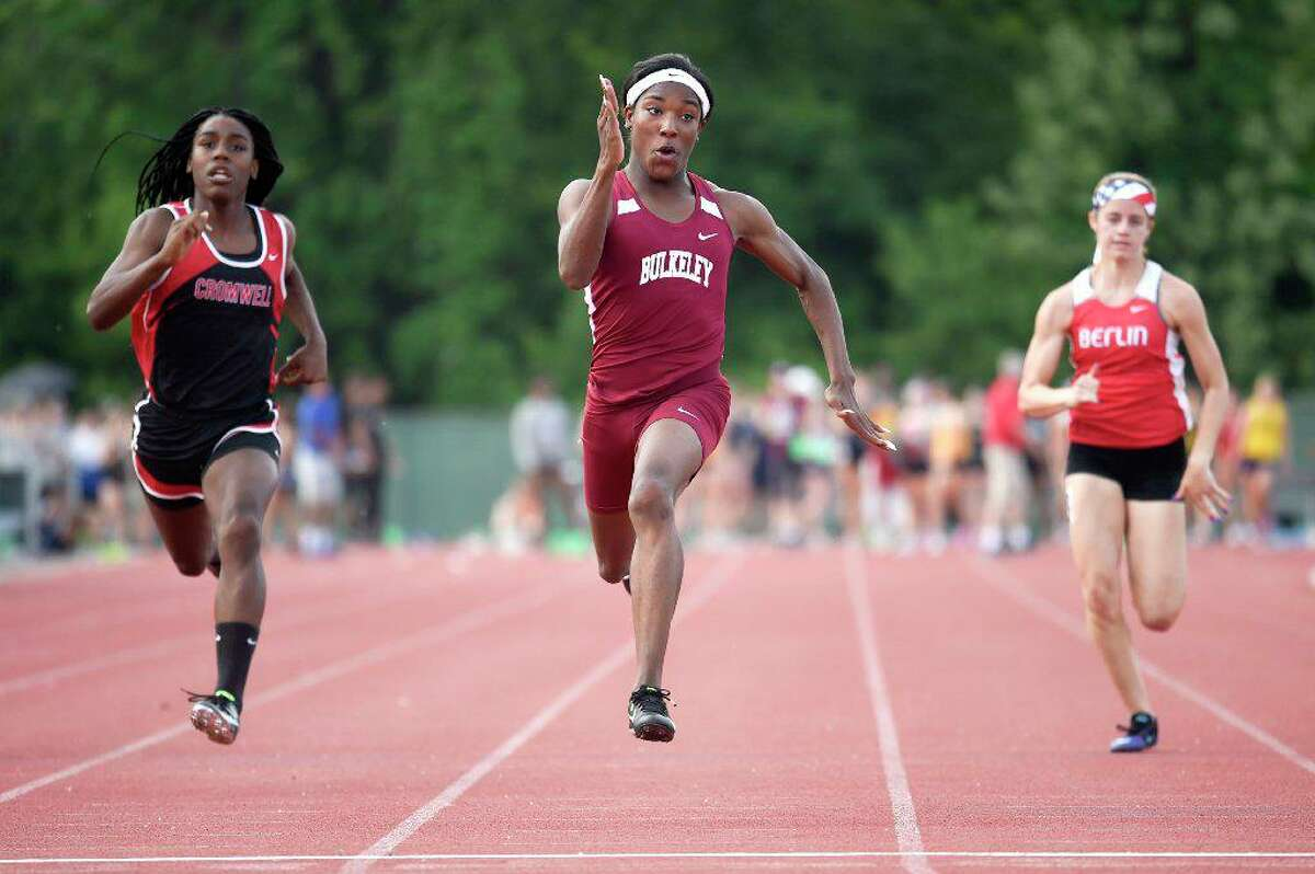 Terry Miller breezed to a first place finish in the 100 meter dash with a time of 11.77 seconds during the State Class M outdoor high school boys and girls track and field championship at Veterans Memorial Stadium in New Britain in May 2018. Andraya Yearwood (L) of Cromwell placed 2nd and Nikki Xiarhos (R) of Berlin placed 3rd. (file photo)