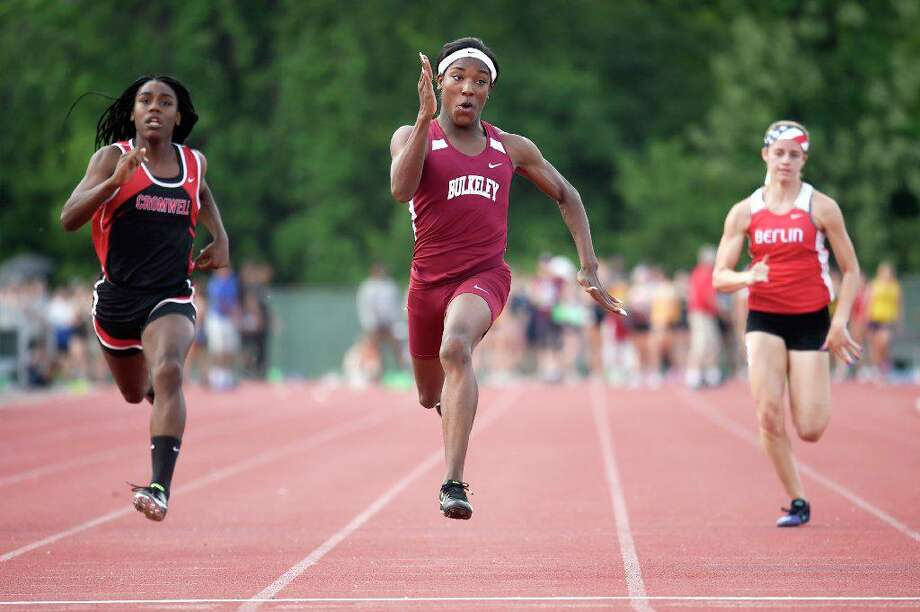 Terry Miller breezed to a first place finish in the 100 meter dash with a time of 11.77 seconds during the State Class M outdoor high school boys and girls track and field championship at Veterans Memorial Stadium in New Britain in May 2018. Andraya Yearwood (L) of Cromwell placed 2nd and Nikki Xiarhos (R) of Berlin placed 3rd. (file photo) Photo: John Woike / Hartford Courant (Courtesy Of CT Mirror)