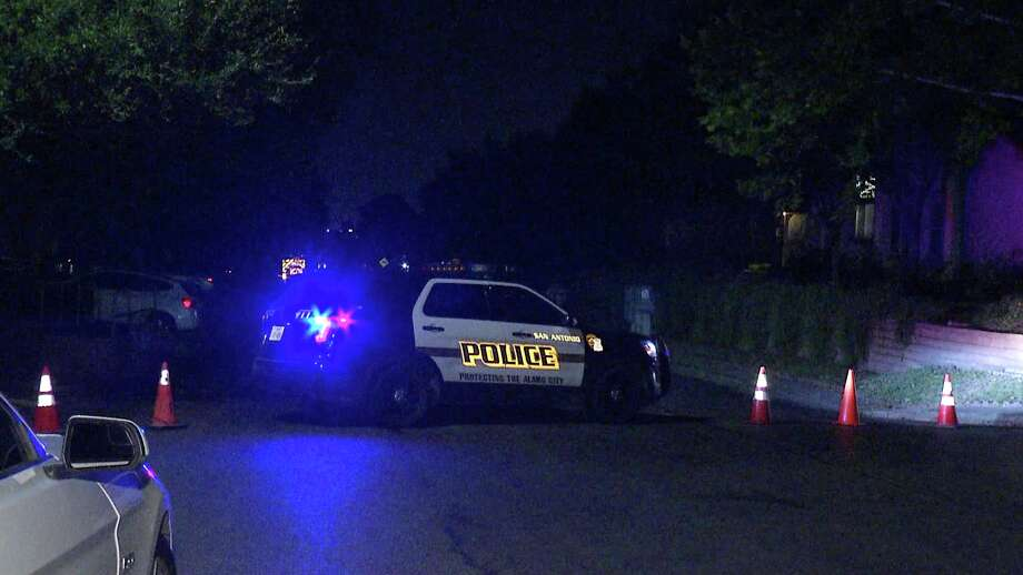 Authorities shut down a neighborhood street on the city's far Northeast side while searching for a robbery suspect Sunday evening, San Antonio police said. Photo: Ken Branca