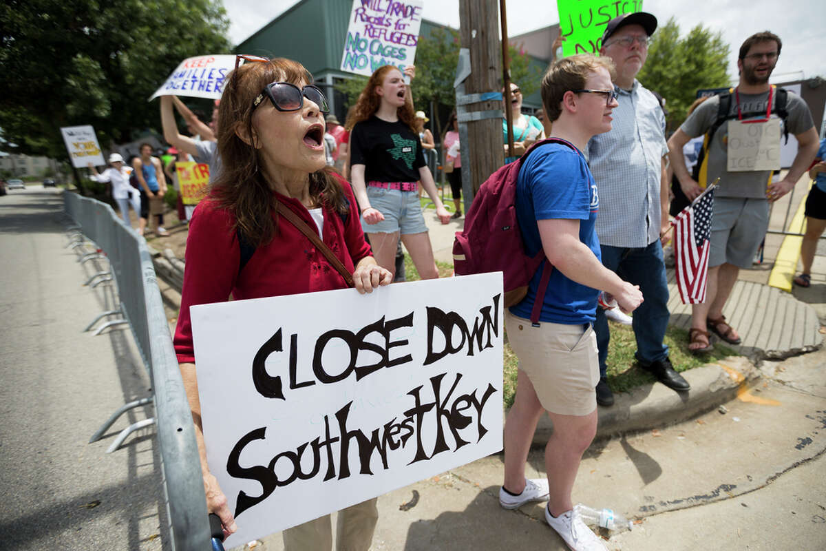 """Beth Moore, left, from League City protests against the Southwest Key Detention Center on Emancipation Ave in Houston, Sunday, July 21, 2019. Never Again Is Now-Houston organized the protest against ICE and the detention center. """"This should hurt everybody's heart,"""" Moore said, """"those are concentration camps."""""""