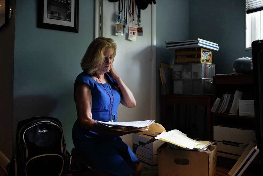 Andrea Chamblee looks through the files of her late husband, John McNamara, who was shot and killed in last year's mass shooting at the Annapolis Capital Gazette. Photo: Washington Post Photo By Sarah L. Voisin. / The Washington Post
