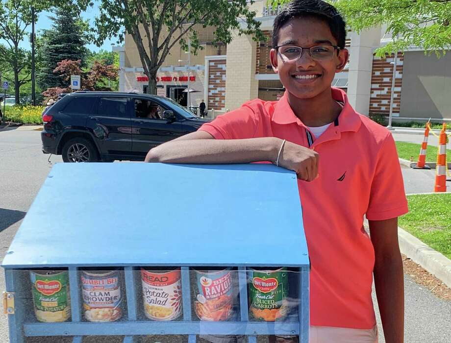 Navod Jayawardhane designed this box that dispenses food and electronically tracks when it needs to be refilled. Photo: Contributed Photo / Wilton Bulletin Contributed