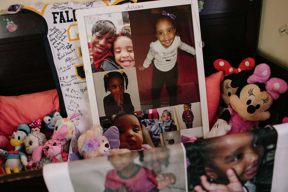 The crib where Autumn Coleman slept is now full of stuffed animals and tributes. Photo: Elizabeth D. Herman For The New York Times