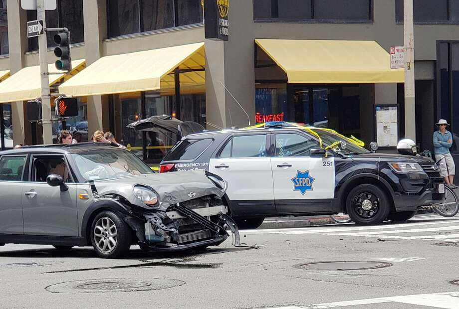 The collision happened at O'Farrell and Taylor streets when the Tesla ran a  red light, slammed into a Mini Cooper, then lost control and hit two  pedestrians in a crosswalk on O'Farrell Street. Photo: Courtesy Photo / Dr. Fudgie