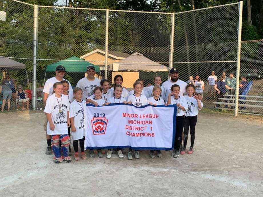 Pictured is the Bullock Creek Little League Softball minor district champion team: (front row, from left) Lily Spann, Bella Kipfmiller, Isabella McNarney, Lily Coyle, Bryanna Herron, Gracie Hammond, Jillian Owen, Kaylin Kraus; (middle row, from left) Easton Murray, Delaney Violette, Jeniffer Young, Jaedyn Heinlein, Ella Stoney; (back row, from left) coaches Nate Owen, Craig Violette, Tom Stoney. Photo: Photo Provided