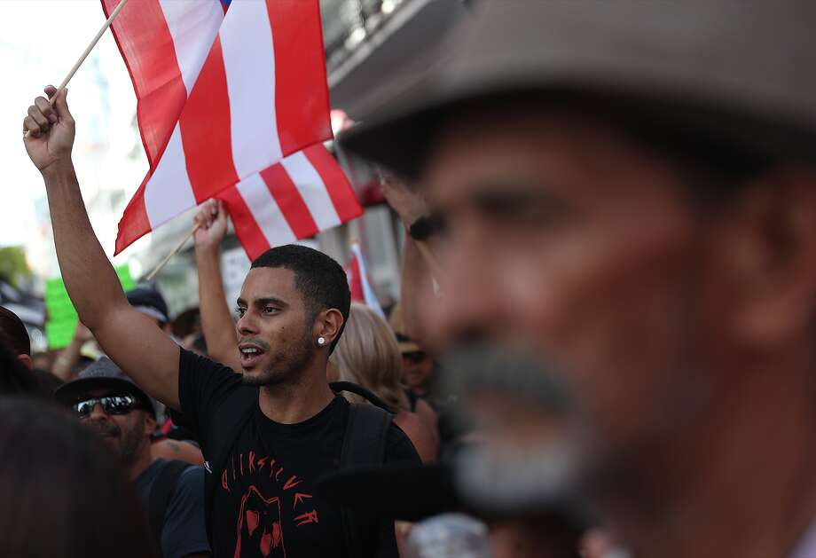 Protesters demonstrate against Ricardo Rossello, the governor of Puerto Rico, near a barricade manned by police along a street leading to the governor's mansion on July 21, 2019 in Old San Juan, Puerto Rico. Protesters have called for the governor to step down after it was revealed that he and top aides were part of a private chat group that contained misogynistic and homophobic messages.  (Photo by Joe Raedle/Getty Images) Photo: Joe Raedle/Getty Images / 2019 Getty Images
