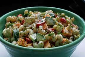 Dill Pickle Ranch Pasta Salad uses pickle juice in the dressing and then added pickle flavor from chopped kosher pickle spears and fresh chopped dill.