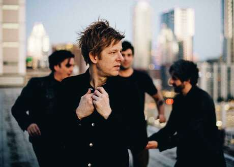 For more than 20 years rock band Spoon has included Jim Eno (left) and Britt Daniel (foreground)