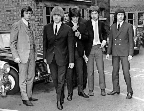 TO GO WITH AFP STORY BY JAMES PHEBY (FILES) A file picture taken in London, on July 22, 1965, shows members of the Rolling Stones band (L-R) Charlie Watts, Brian Jones, Keith Richards, Mick Jagger and Bill Wyman. Most London shoppers rush by 165 Oxford Street without a second glance -- but it was here 50 years ago that The Rolling Stones played their first gig and changed the landscape of pop music forever. Mick Jagger, Keith Richards and Brian Jones played The Marquee Club on July 12, 1962 with three others, the first time they performed under the band name which would become synomymous worldwide with excess and muscial flair. AFP PHOTO /FILES-/AFP/GettyImages