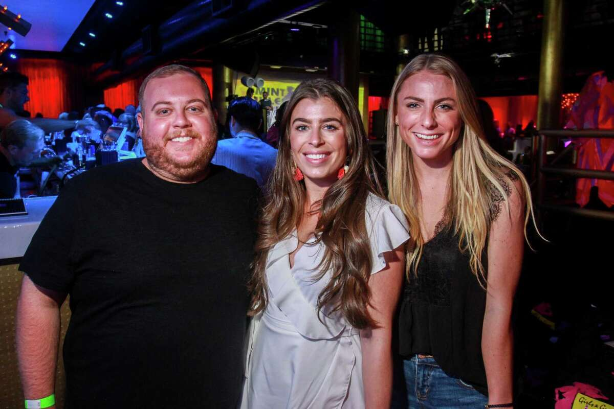 Brian Brumley, from left, Jaclyn DiGulio and Chelsea Donovan at Legacy Community Health's annual Mint Julep 'Girls & Guys Just Wanna Have Fun,' at Rich's Houston.