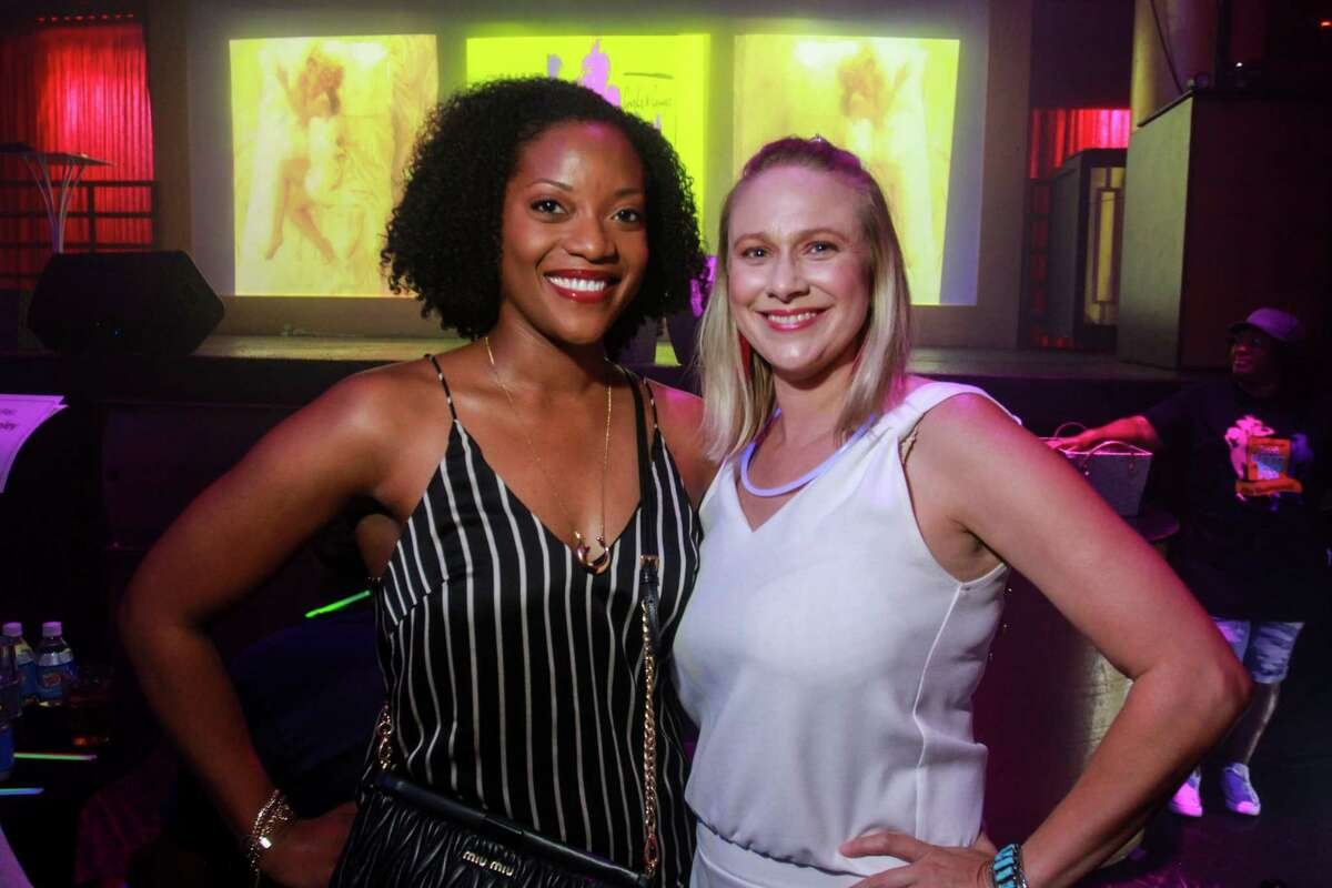 Kemi Nurudeen, left, and Tiffany D'Antonio at Legacy Community Health's annual Mint Julep 'Girls & Guys Just Wanna Have Fun,' at Rich's Houston.