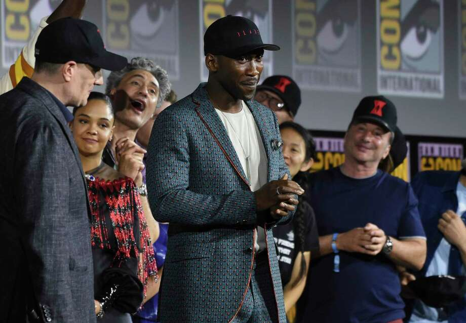 "Mahershala Ali, center, wears a hat to promote his new movie ""Blade"" at the Marvel Studios panel at Comic-Con International. Photo: Chris Pizzello /Associated Press / Invision"