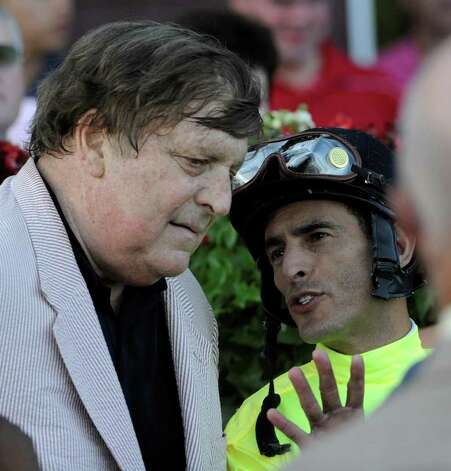 Edward P. Evans, owner of A Little Warm, speaks with jockey John Velazquez after winning the Jim Dandy, a prep for the Travers, at Saratoga Race Course. (Skip Dickstein/Times Union) Photo: Skip Dickstein