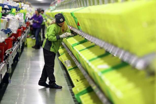 An employee picks an order at the Ocado Group distribution centre in Dordon, England, on Dec. 16, 2016.