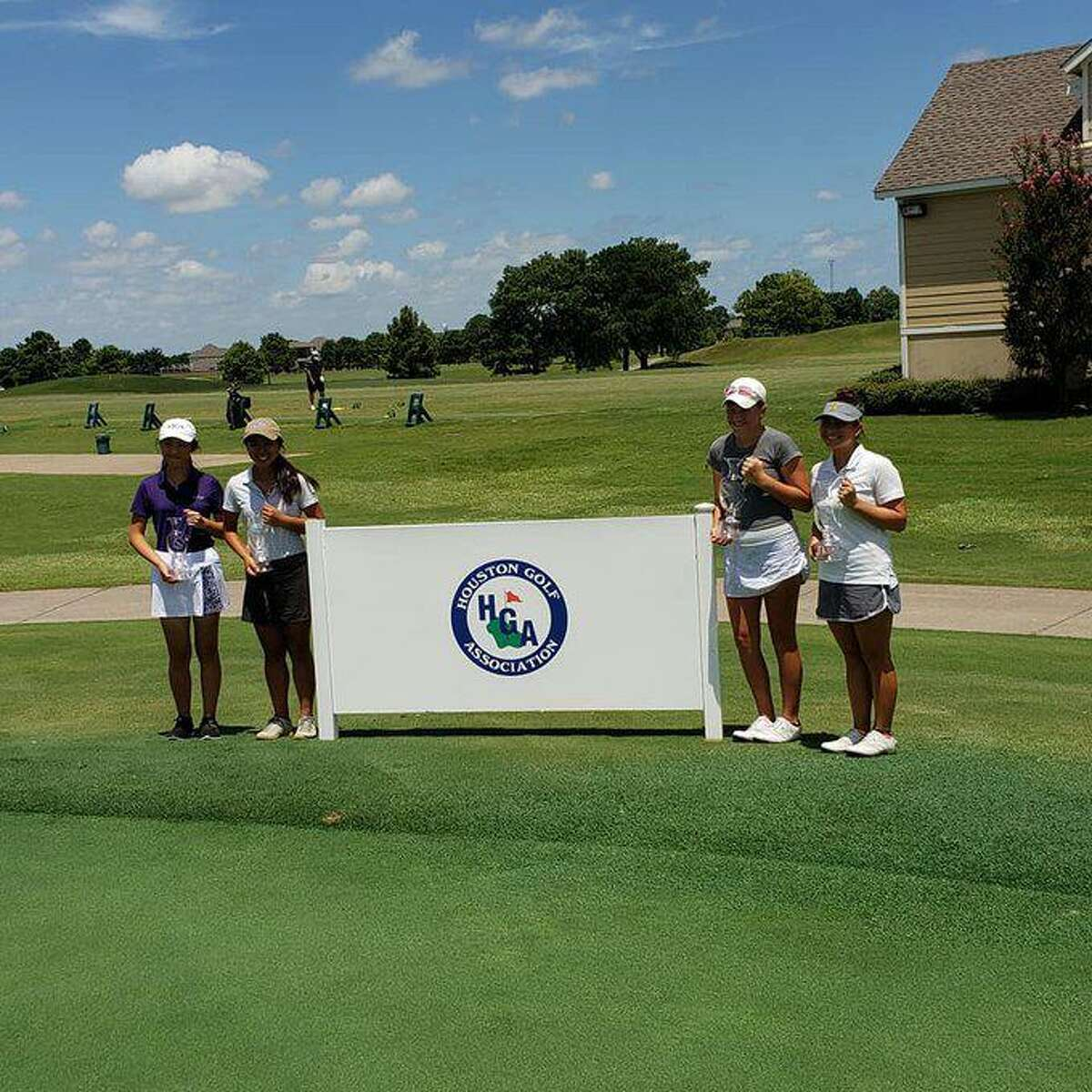 Houston City Junior Championships semifinalists Natalie Cao, Jacqueline Nguyen, Mallorie Luitwieler and Valerie Routzong pose with their trophies following match play July 18 at Cypress Lakes Golf Club.