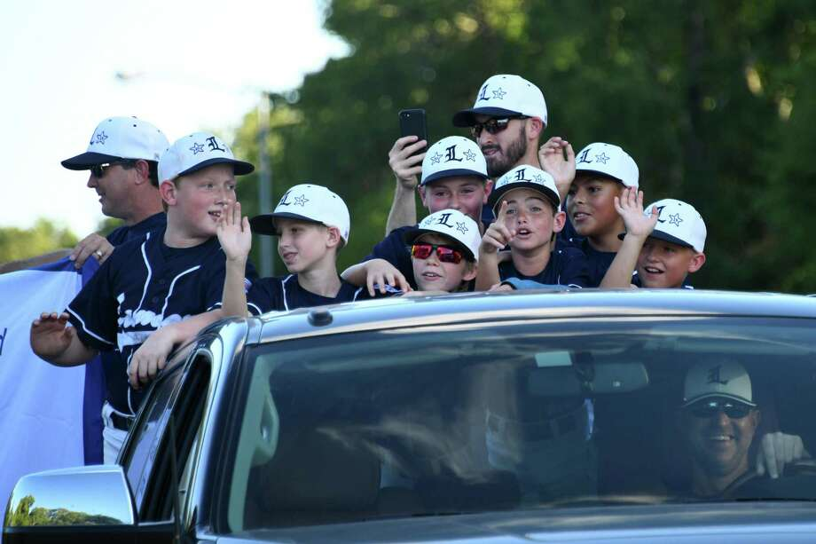 The Lamar National 11U Little League team waves to fans during a send-off celebration on Thursday, July 18, 2019 at George Park, Richmond, TX. The team is heading to the Texas East state little league tournament in Tyler, TX. Photo: Craig Moseley, Houston Chronicle / Staff Photographer / ©2019 Houston Chronicle