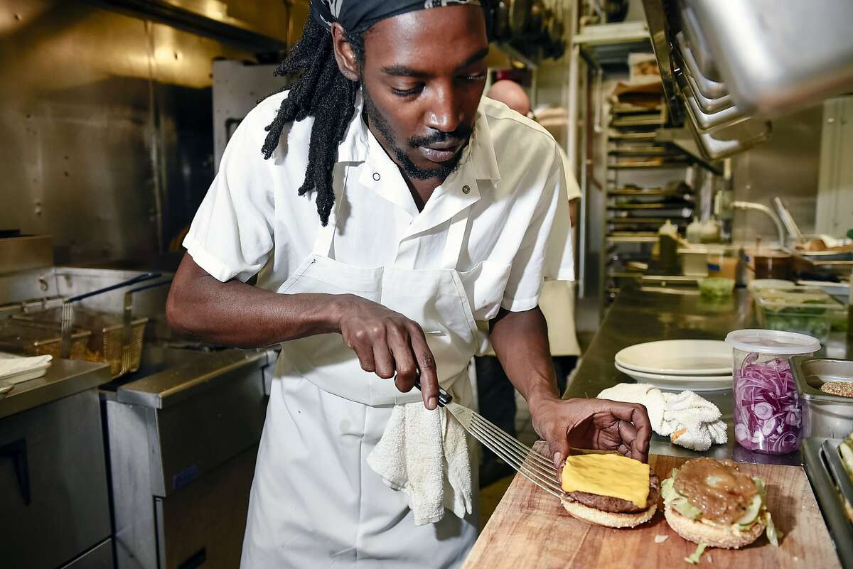 Chef de partie Kenny McLeod assembles an Impossible Burger order in the kitchen at Violet's restaurant in San Francisco, Calif., on July 21st, 2019. Impossible Foods is distributing Impossible Burgers to independent restaurants again after a two-month dry spell, which coincided with its expansion to Burger Kings nationwide.