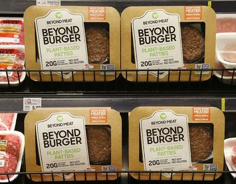 A meatless burger parry called Beyond Burger is on display at a grocery store in Richmond, Va., Thursday, June 27, 2019. (AP Photo/Steve Helber)