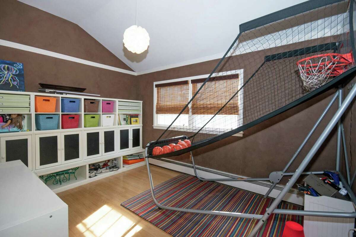 One of the bedrooms is currently used as a game or recreation room.