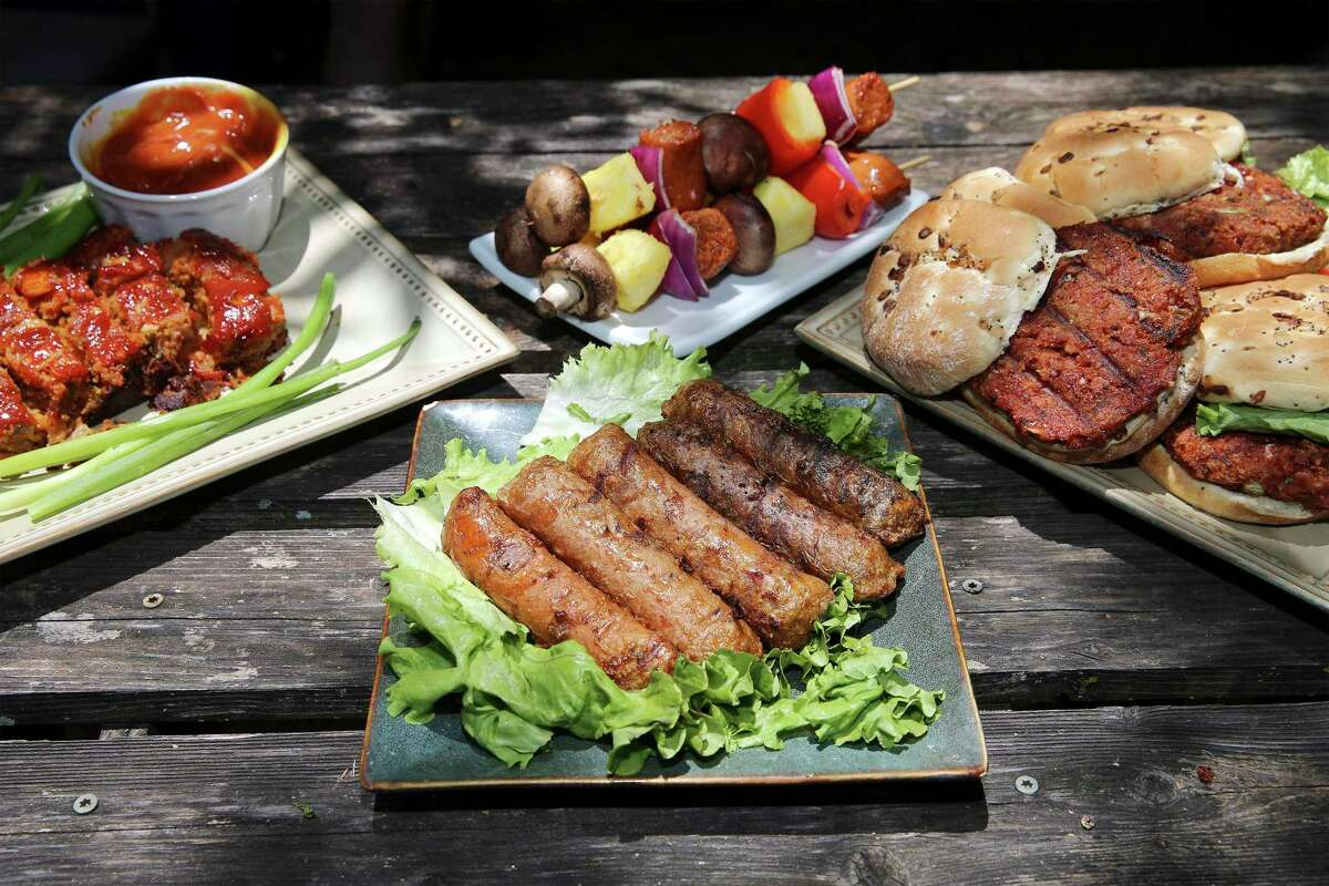 An assortment of finished products made with Beyond Meat include (from top left): smoked meatloaf, Italian sausage kabobs, burgers and full bratwurst and Italian sausages.
