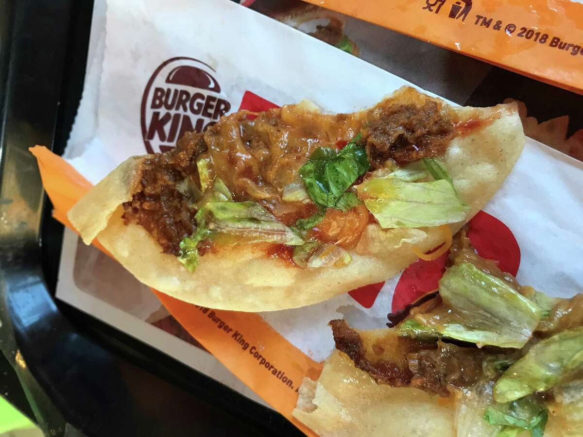We pulled apart the new Burger King taco to see what's inside.