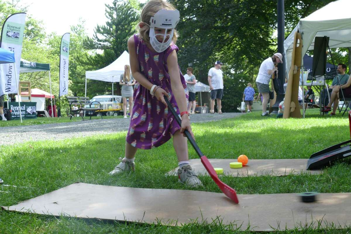 Charlotte, 6, of North Salem plays hockey at the Winter Garden Arena exhibit in Ballard Park at Ridgefield's annual Summerfest event on July 20.