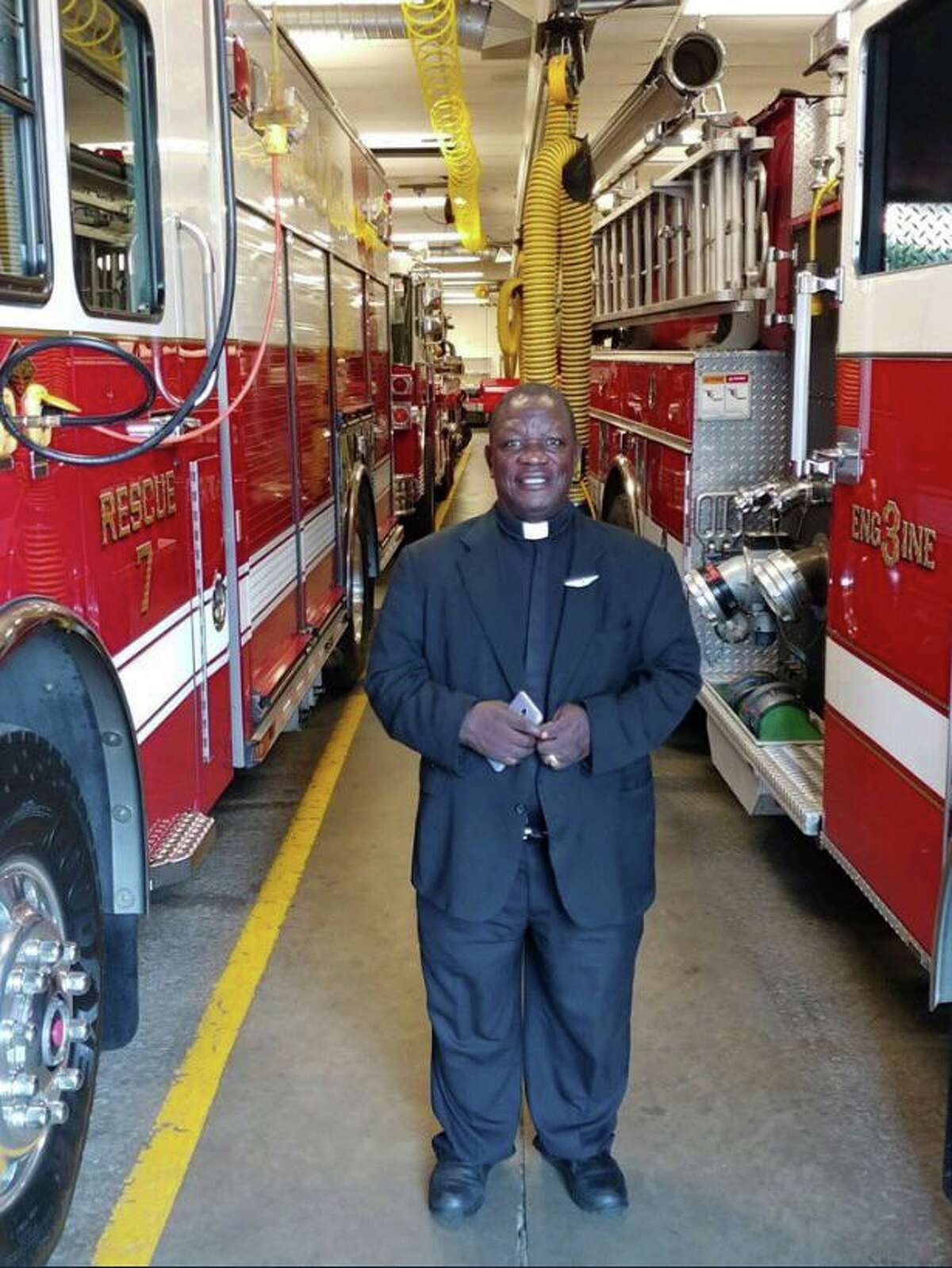 Father Joseph Dube, who was visiting St. Mary's Parish all the way from the Diocese of Sokoto in Northern Nigeria, dropped by the Ridgefield Fire Department headquarters on Catoonah Street earlier this week. Ridgefield Capt.RichardLawlor, an ordained Deacon, brought Father Dube for a tour of headquarters.