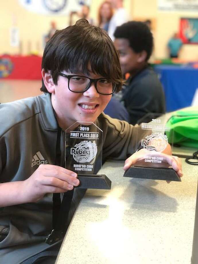 Macdonough Elementary School Rubik's Cube competitor Rye Antonio solved the three-dimensional puzzle in 17.9 seconds. Photo: Contributed Photo