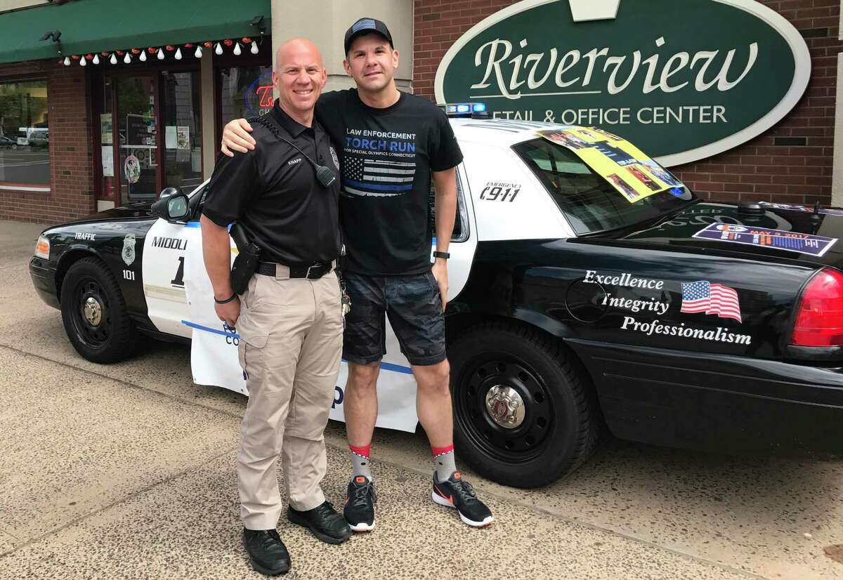 The Eastern Connecticut State University Police Department, Willimantic Police Department and Middletown Police Department will hold its 6th annual Tip a Cop benefit for Special Olympics of Connecticut Thursday at Amici Italian Grill in Middletown. Shown here are Middletown Officer Anthony Knapp, left, and Angelo Simoni Jr., head of the ECSU Office of Student Conduct.