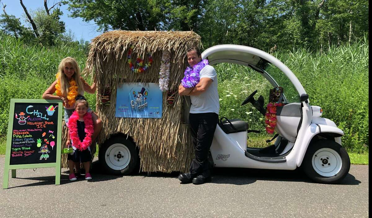 Colleen Reese, Jaxx, and Stephen Cristoforo pose next to Chill Hawaiian Shave Ice, Ridgefield's newest food truck.