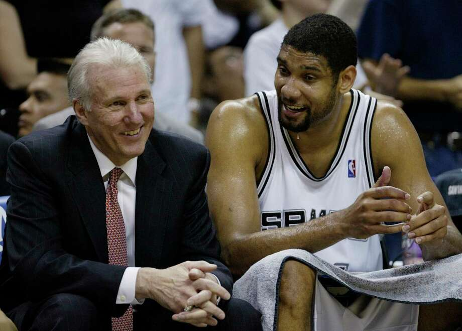 FILE - In this April 5, 2007, file photo, San Antonio Spurs forward Tim Duncan (21) talks with Spurs coach Gregg Popovich, left, during the fourth quarter of their NBA basketball game against the Phoenix Suns in San Antonio. (AP Photo/Eric Gay, File) Photo: Eric Gay, Associated Press / AP2007
