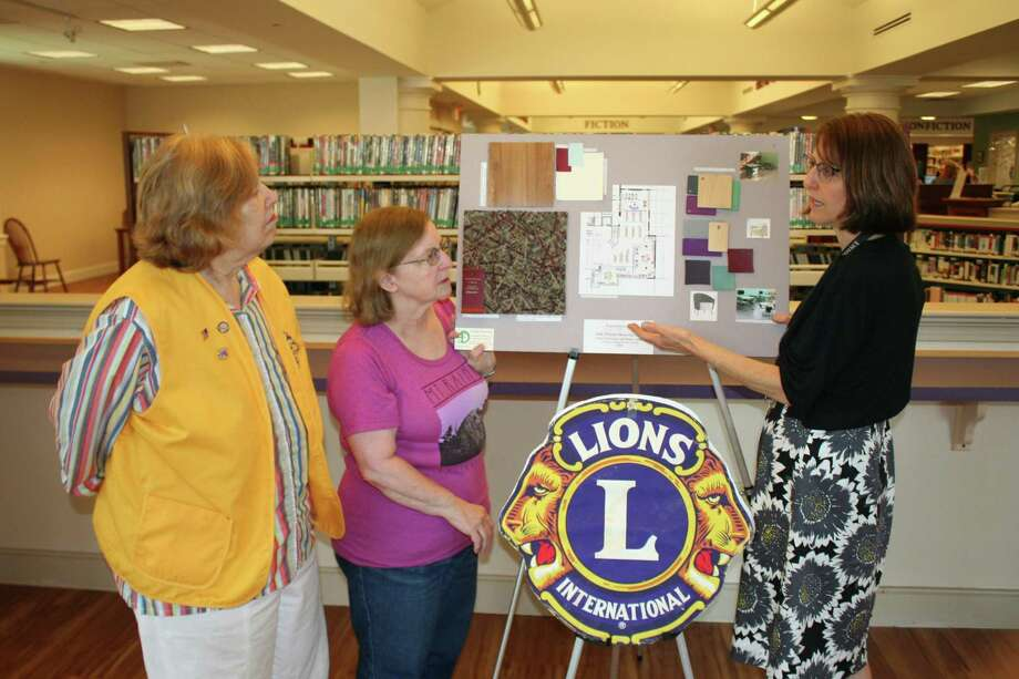 Photo left to right: Monroe Lions Club President: Adria Perlman; Friends of the Edith Wheeler Memorial Library President: Lorraine Riedel; Library Director: Lorna Rhyins Photo: Courtesy Of The Edith Wheeler Memorial Library / Contributed