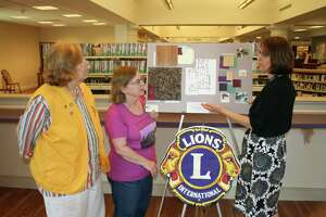 Photo left to right: Monroe Lions Club President: Adria Perlman; Friends of the Edith Wheeler Memorial Library President: Lorraine Riedel; Library Director: Lorna Rhyins