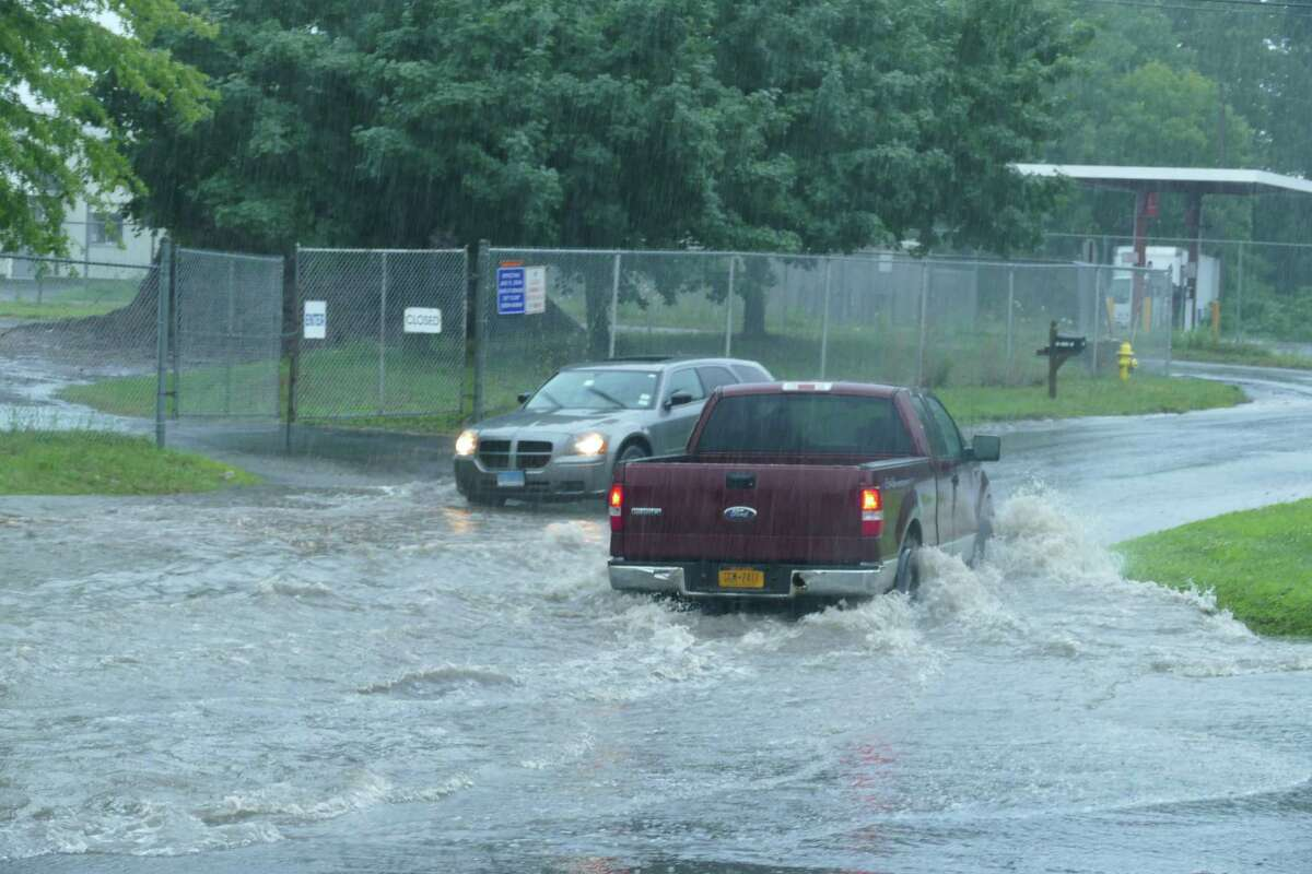 Flooding on South Street in Ridgefield had cars turning around in both directions Monday, July 22, 2019.