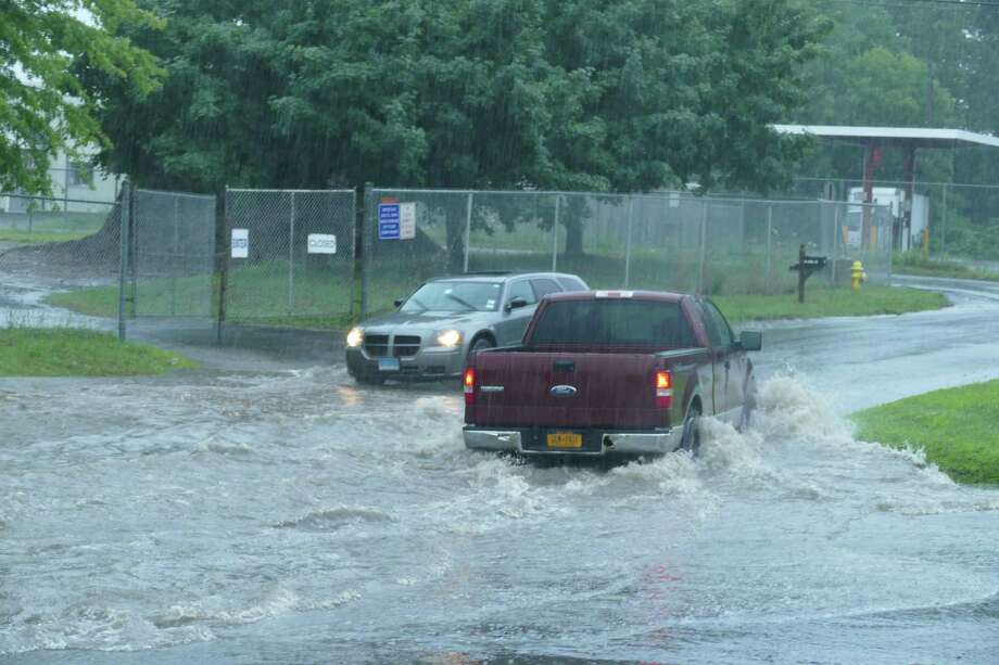 Flooding on South Street in Ridgefield had cars turning around in both directions Monday, July 22, 2019. Photo: Stephen Coulter / Hearst Media