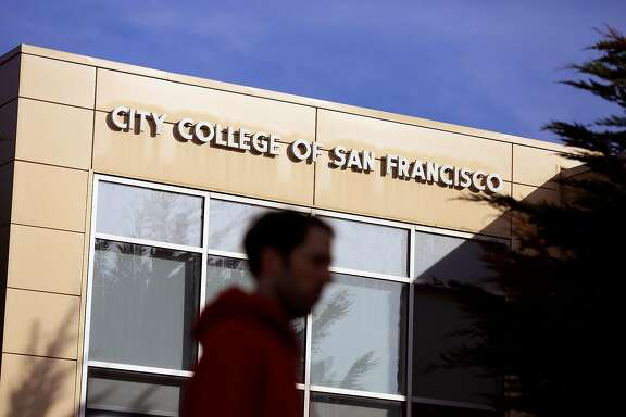 A person walks past the Student Health Center at City College of San Francisco on Friday, December 8, 2017 in San Francisco, Calif.