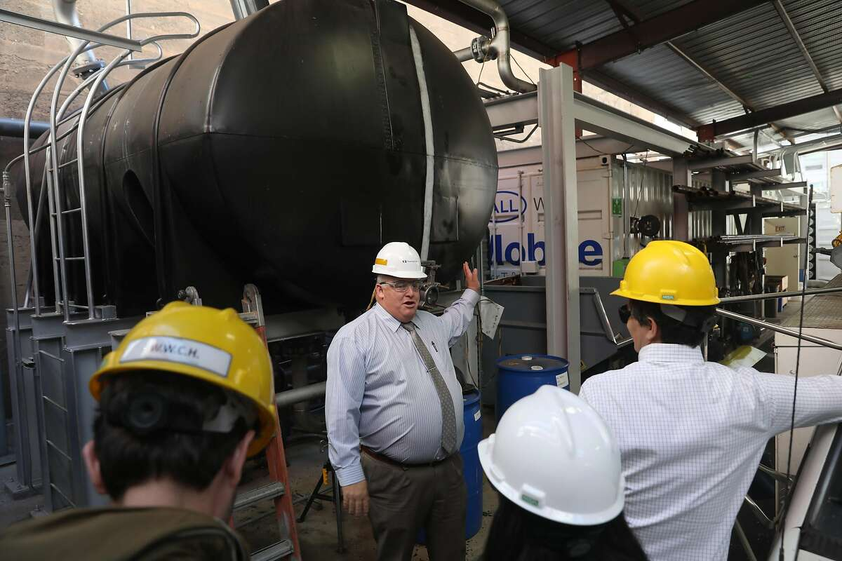 General manager Gordon Judd (middle) shows the initial receiving tank at Energy Center San Francisco in San Francisco on Tuesday, July 16, 2019 in San Francisco, Calif.