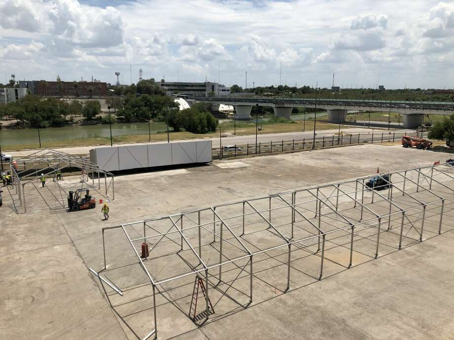 These photos show the construction of tent facilities in Laredo for asylum seekers near the International Bridge. Photo: Maria Salas/Laredo Morning Times