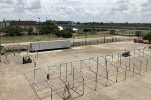 These photos show the construction of tent facilities in Laredo for asylum seekers near the International Bridge.
