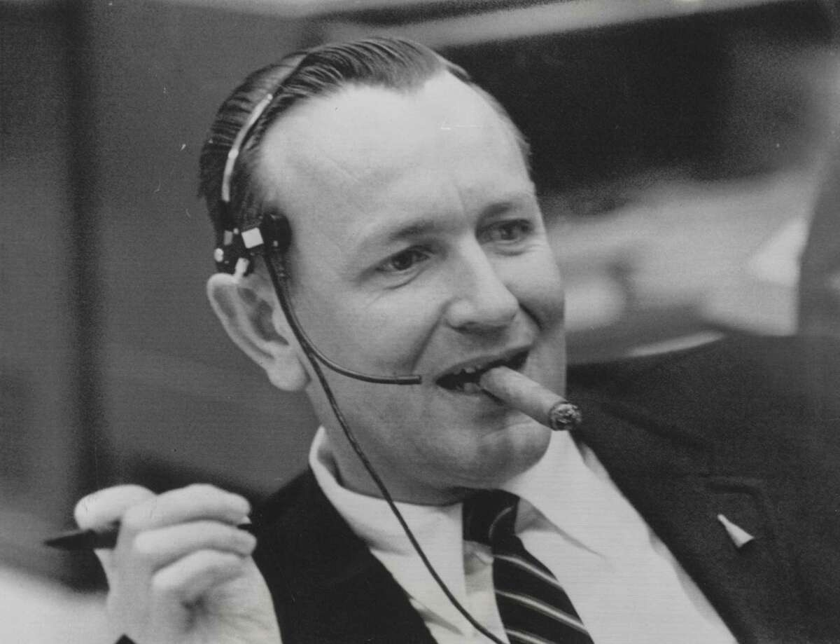 Christopher C. Kraft, Gemini flight director, appears in a relaxed, confident mood as he sits at the console in Mission Control at Manned Spacecraft Center - now named the Johnson Space Center - in Houston on Dec. 7, 1965 and receives reports on the flight of Gemini 7. The orbital flight of Lt. Col. Frank Borman and Commander James A. Lovell was one of the most successful, trouble-free flights of the Gemini program.