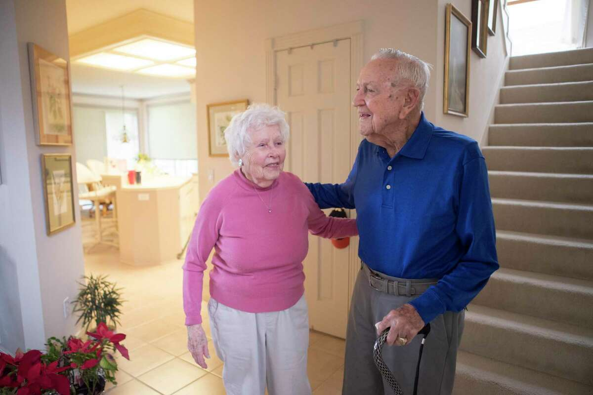 Chris Kraft places his arm around his wife, Betty (Turnbull) Kraft's back at their home on Friday, Feb. 22, 2019, in Clear Lake. Chris Kraft is NASA's first mission control flight director. They have been married almost 69 years at the time of his death on Monday, July 22, 2019.