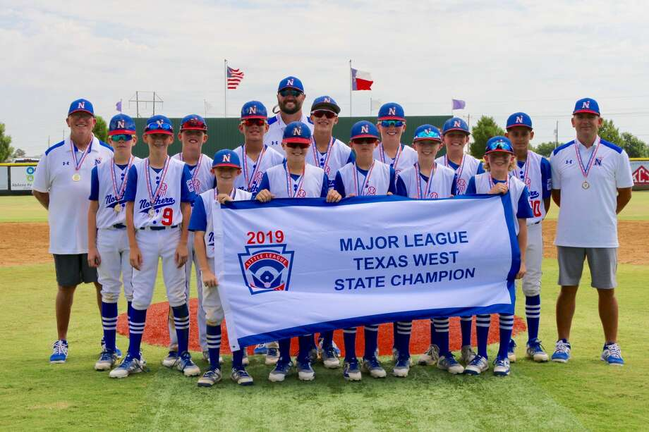 The Midland Northern Little League All-Stars pose with their championship banner after winning the Texas State West Little League title on Monday at Wylie Little League Fields in Abilene. Photo: Courtesy Photo