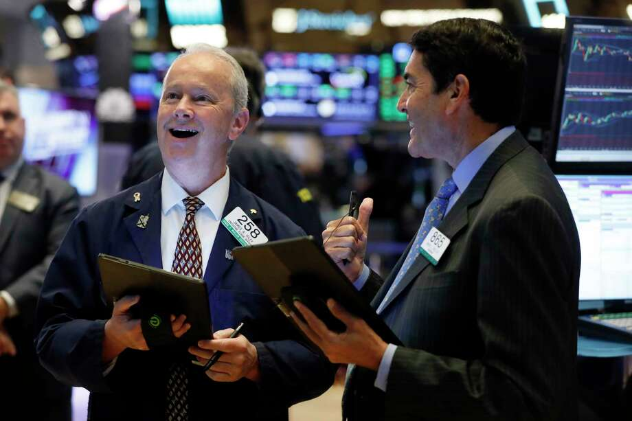 Traders James Riley, left, and Mark Muller work on the floor of the New York Stock Exchange, Monday, July 22, 2019. U.S. stocks moved higher in early trading Monday on Wall Street as investors snapped up technology stocks. (AP Photo/Richard Drew) Photo: Richard Drew / Copyright 2019 The Associated Press. All rights reserved.